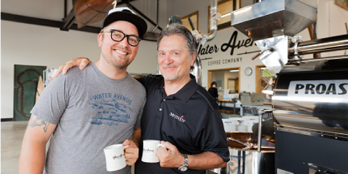 Bruce Milletto (right) and his son, Matt, in Water Avenue Coffee's roastery.
